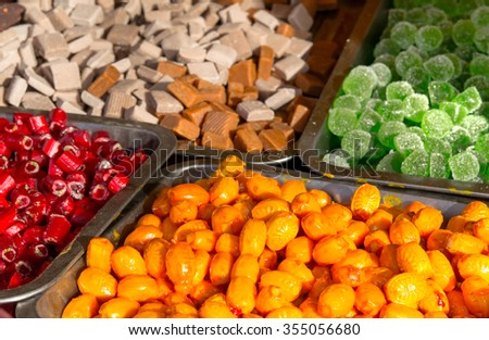 confectionery colorful candy Christmas winter sale stand - stock photo