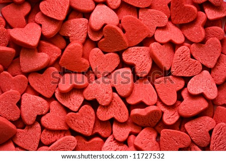 Confectionery ornaments in the form of red hearts close up
