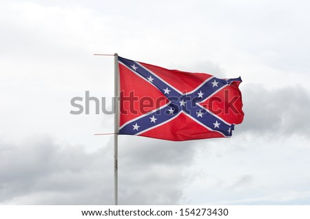 Confederate flag flying - stock photo
