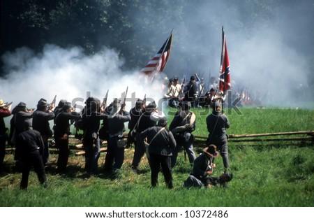 Confederate soldiers advance,Civil War battle reenactment - stock photo