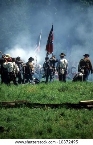 Confederates defend the flag, Civil War battle reenactment - stock photo