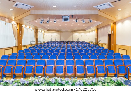Conference hall with blue chairs - stock photo