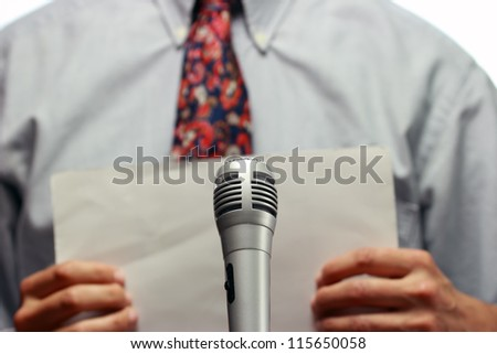 Conference meeting microphone and out of focus businessman - stock photo
