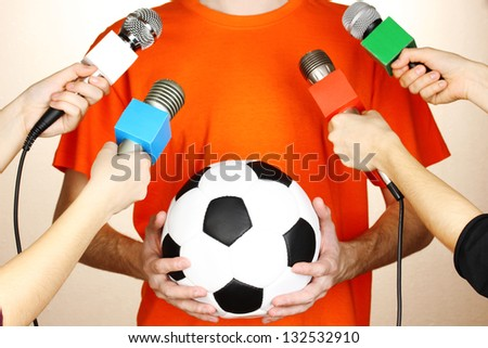 Conference meeting microphones and footballer - stock photo