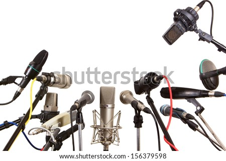 Conference meeting microphones prepared for talker - isolated on white background  - stock photo