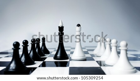 Conference metaphor in chess pieces having deal. - stock photo