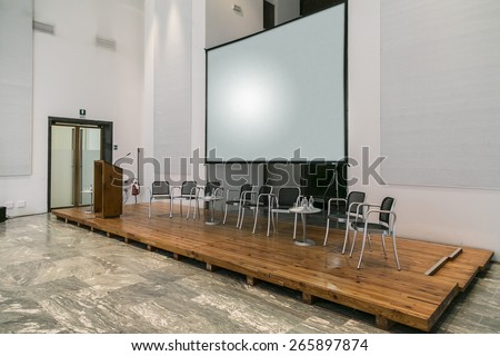 conference room fitted with screens and projectors  - stock photo