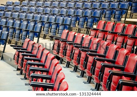 Conference room full of blue and red seats - stock photo