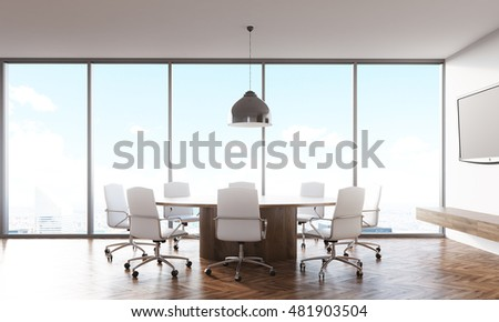 Conference room interior with round wooden table, white leather armchairs around it and tv set on white wall. Concept of business communication and working together. 3d rendering