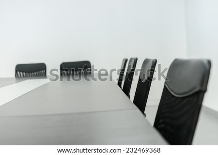 Conference room tables and chairs - stock photo