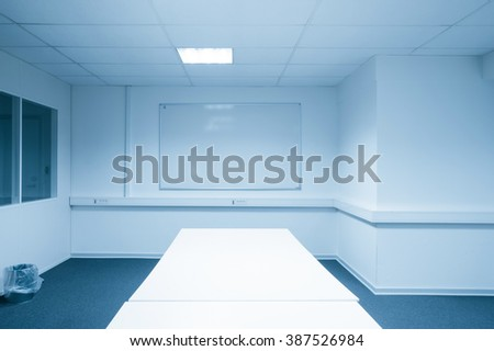 Conference room with a whiteboard in blue tone - stock photo