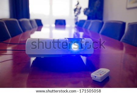 Conference room with projector - stock photo
