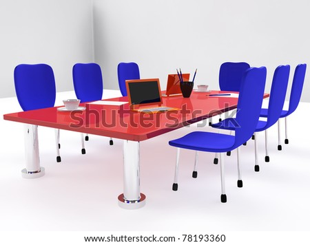 Conference room with red desk and blue chairs