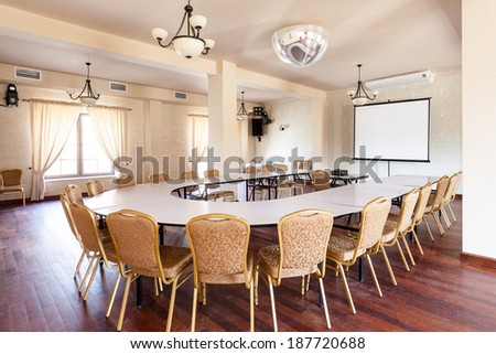 Conference room with round table and projector - stock photo