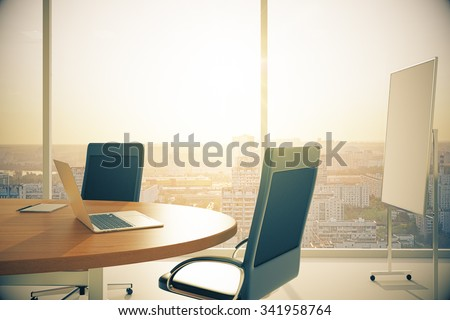 Conference room with wooden table with laptop and blackboard at sunset 3D Render - stock photo
