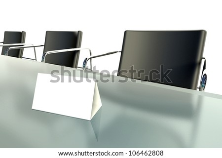 Conference table and blank place card on white background - stock photo