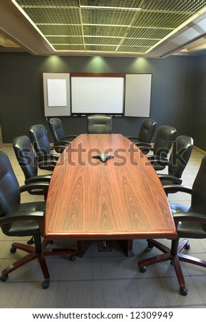 Conference table and blank presentation board.