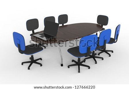 Conference table and chairs with laptop