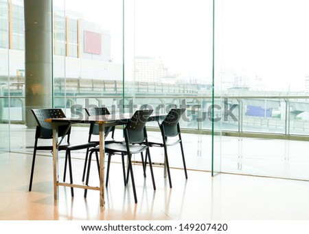 Conference table by the window.