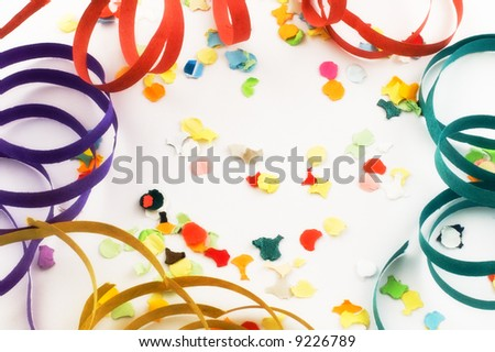 Confetti and streamers on white background with slight diffuse filter