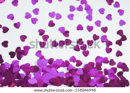 Confetti hearts on a white background, pink confetti in honor of Valentine's day, template for postcard