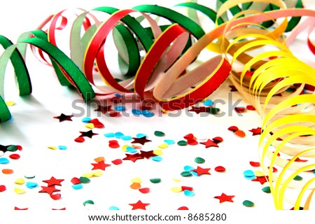 Confetti on white background with streamers