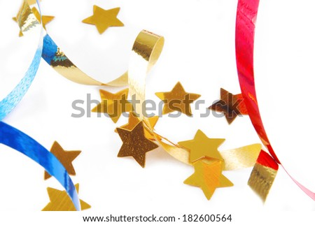 confetti serpentine ribbon isolated on white - stock photo
