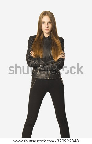 Confidence young woman portrait in black. - stock photo