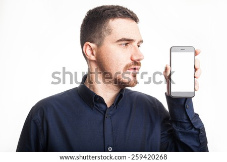 Confident Adult Showing a Mobile Phone With White Screen - stock photo