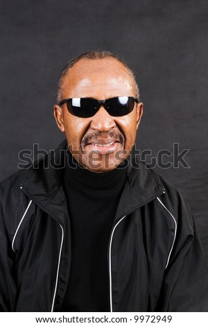 confident african american man retirement age wearing glasses