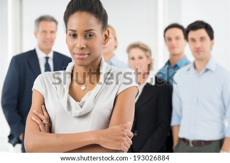Confident African Businesswoman In Front Of Office Staff - stock photo