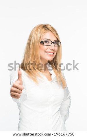 Confident and beatiful blonde woman with thumbs up gesture wearing eyewear glasses