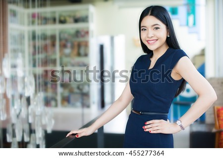 Confident and Smart Asian woman in office background (Focus on eyes)