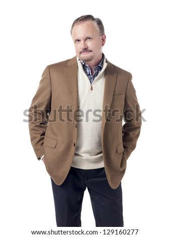 Confident and smiling old businessman with hand on his pocket