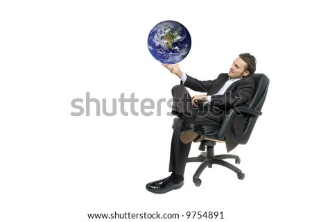 confident and successful young adult businessman holding the world