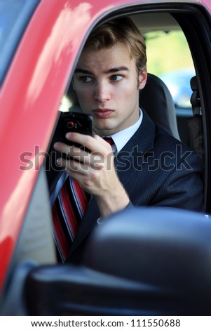 Confident and Young, Professional Business Man Texting While Driving - stock photo