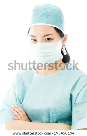 Confident Asian female surgeon with arms crossed