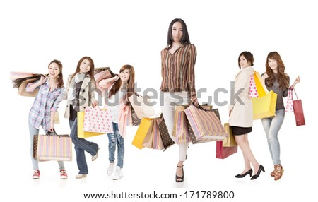 Confident Asian shopping woman with her friends, full length on white background. - stock photo