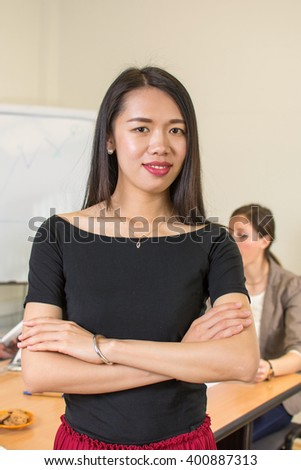 Confident asian woman leader at the office