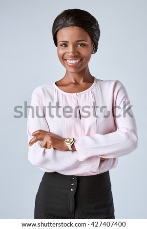 Confident black african business woman portrait smiling at camera - stock photo
