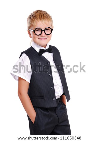 Confident boy in bow tie and suit