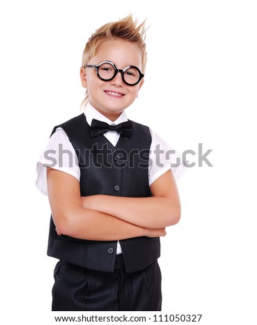 Confident boy in bow tie and suit with crossed hands