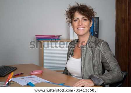 Confident brunette woman at work