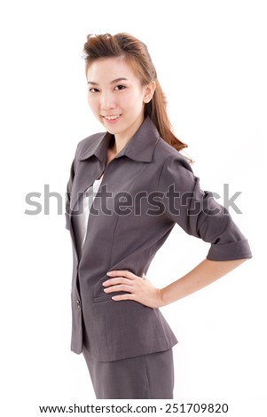 confident business executive looking at camera, arms akimbo - stock photo