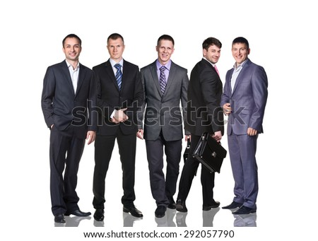 Confident business executive with his team on white background - stock photo