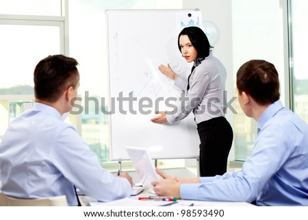 Confident business lady carrying out presentation of a business plan - stock photo