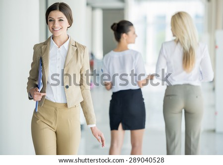 Confident business lady in suit moving at office. - stock photo