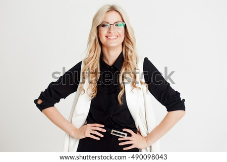 Confident business lady, looking at camera, white background. Place for you text on the right
