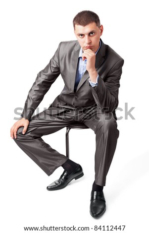 confident business man portrait sitting on a chair isolated on white background - stock photo