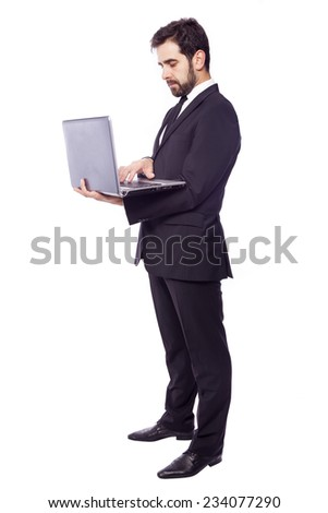 Confident business man with a laptop, isolated on white background